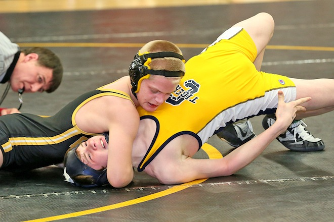 Four Trojan wrestlers headed to state